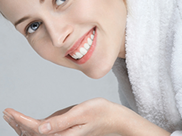 Woman smiling about to wash her face